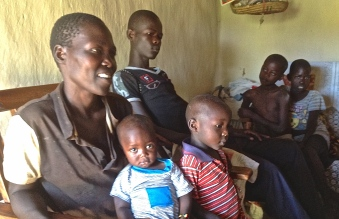 Caroline, a Luo Care beneficiary with her children.